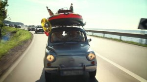 stock-footage-small-car-filled-with-children-toys-road-toward-beach